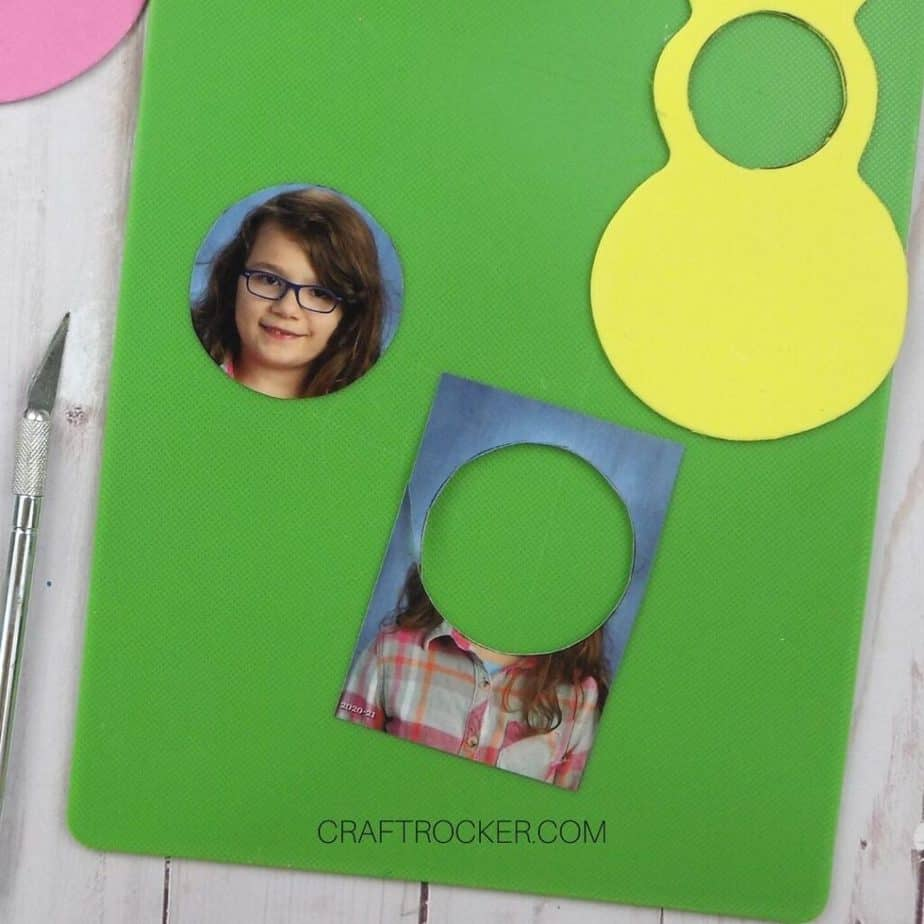 Circle with Face Cut out of Wallet Size Photo on Cutting Board - Craft Rocker