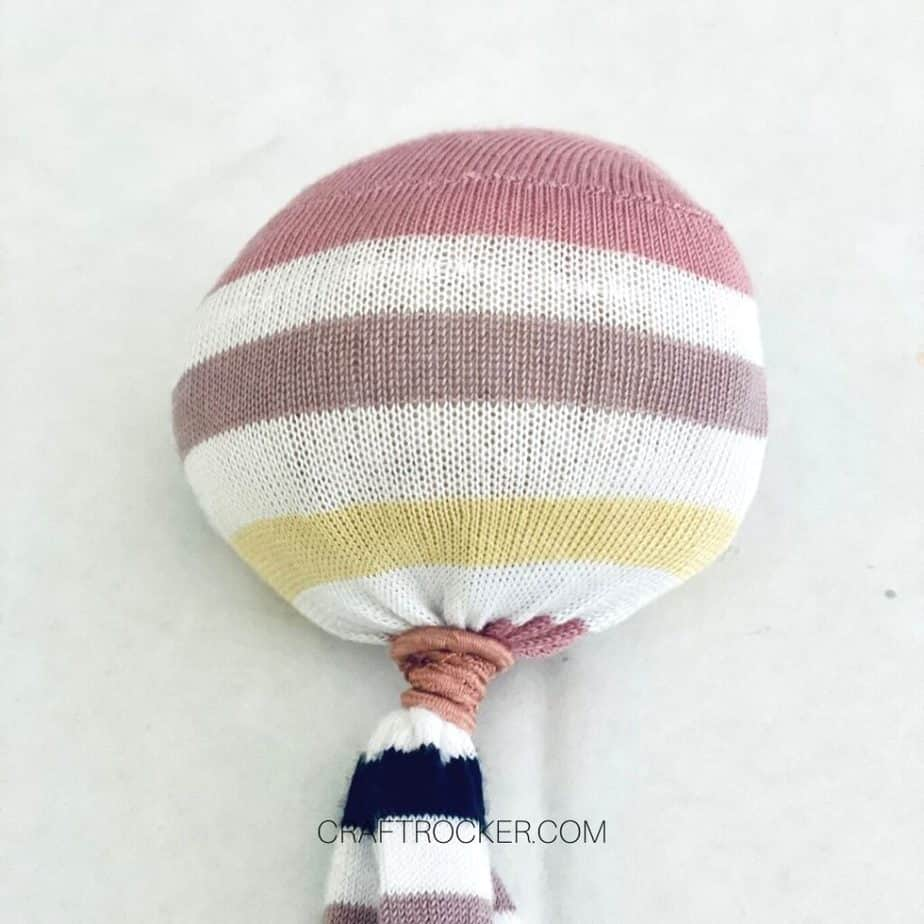Close Up of Hair Tie Wrapped Around Striped Sock - Craft Rocker
