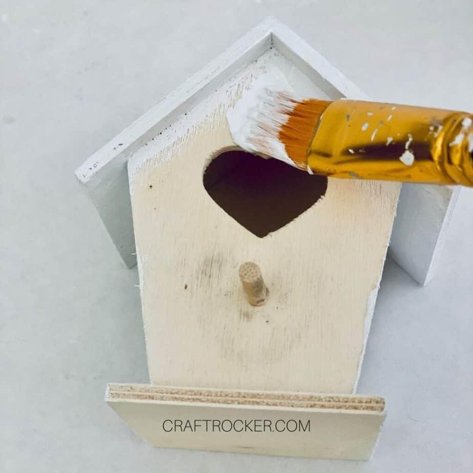Close Up of Paintbrush Adding White Paint to Bird House - Craft Rocker