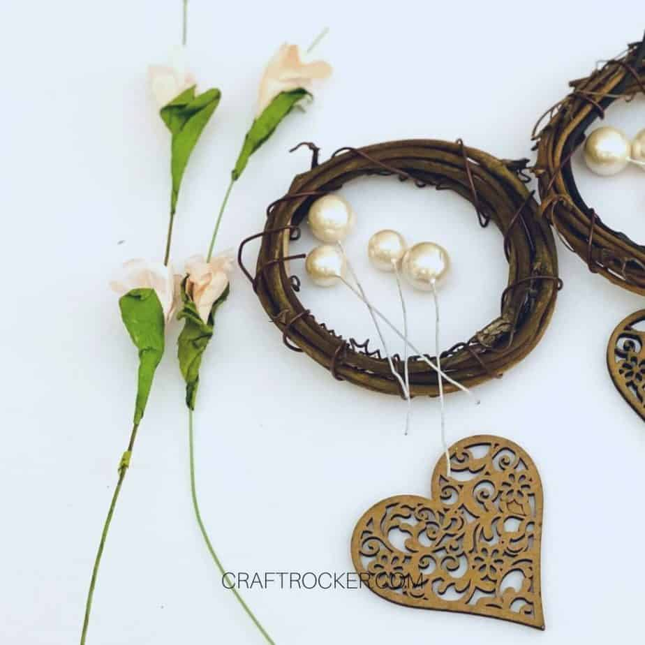 Close Up of Pink Flowers and Pearl Stems on Mini Grapevine Wreath - Craft Rocker