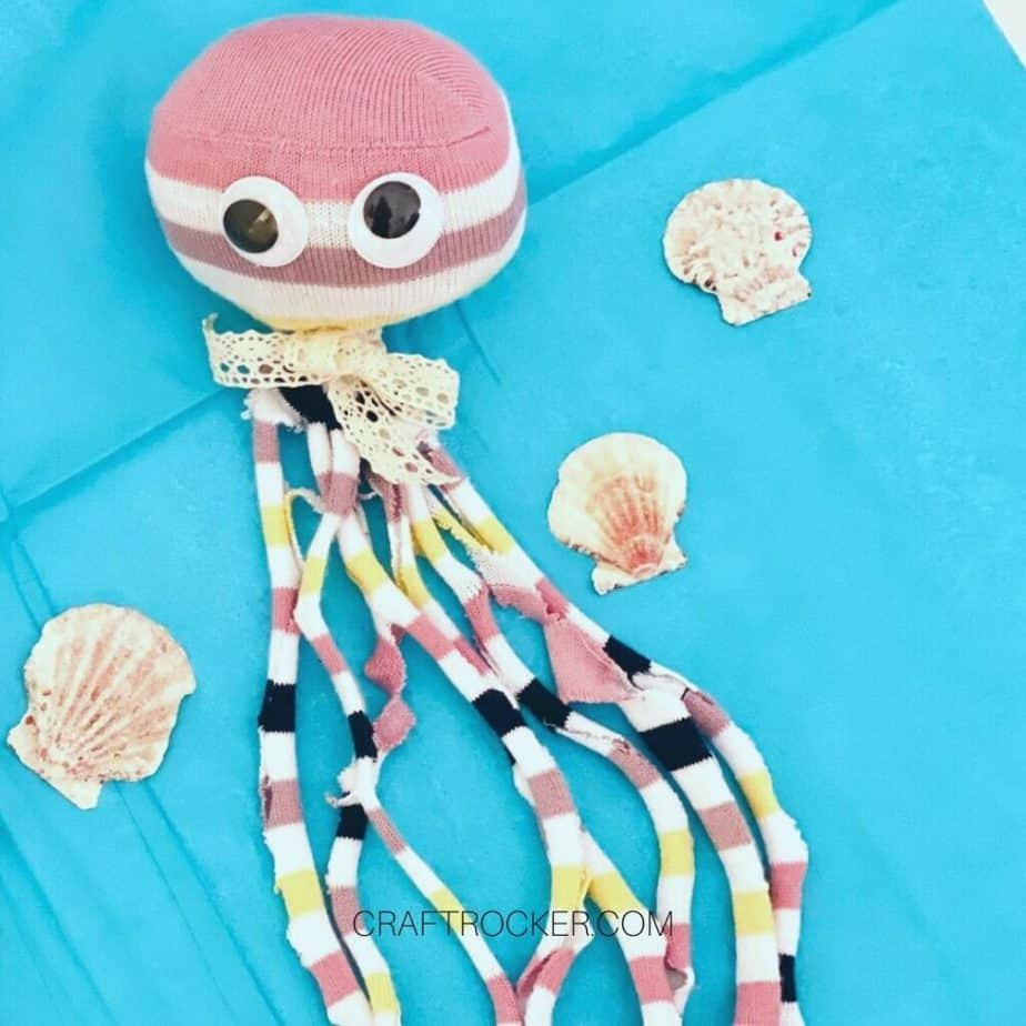 Close Up of Striped Octopus Toy on Blue Background - Craft Rocker