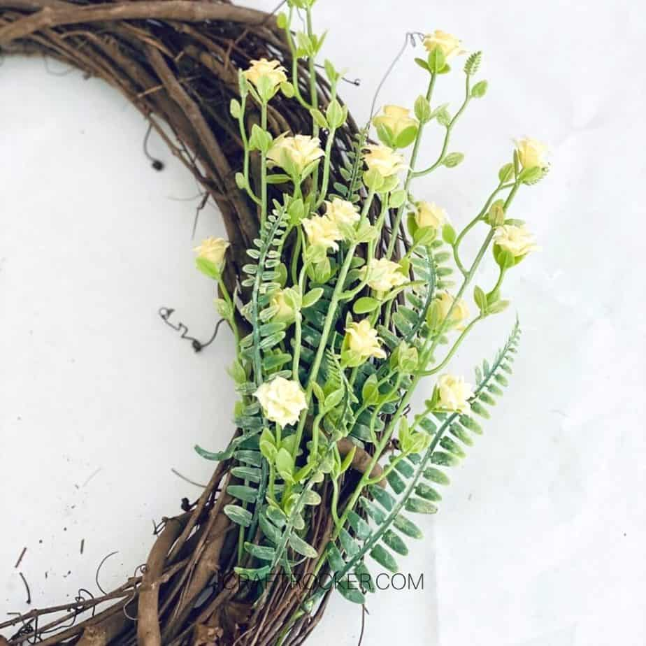 Close Up of Yellow Flowers in Right Side of Grapevine Wreath - Craft Rocker