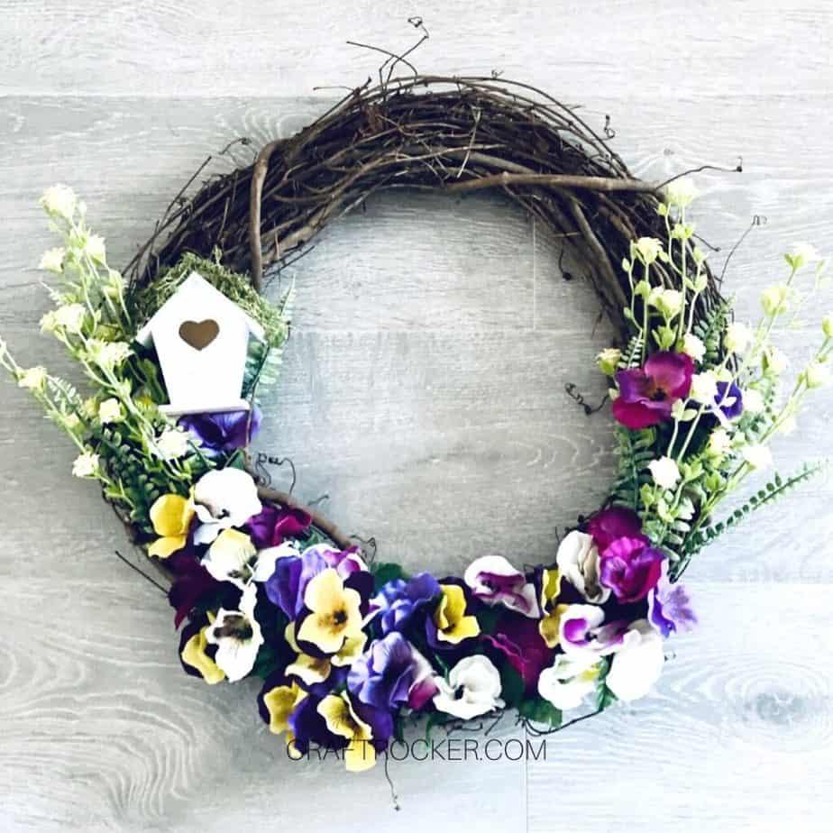 Dollar Tree Spring Wreath on Wood Background - Craft Rocker