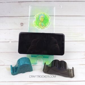 Phone on Rick Phone Holder next to Elephant and Mustache Holders - Craft Rocker