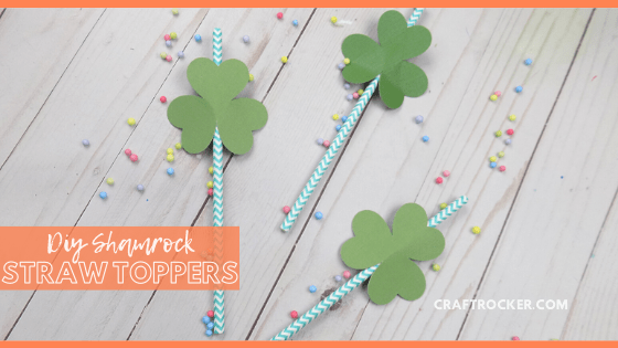 Straws with Toppers on Wood Background with text overlay - DIY Shamrock Straw Toppers - Craft Rocker