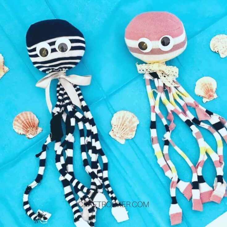 Striped Octopus Toys on Blue Background Next to Shells - Craft Rocker