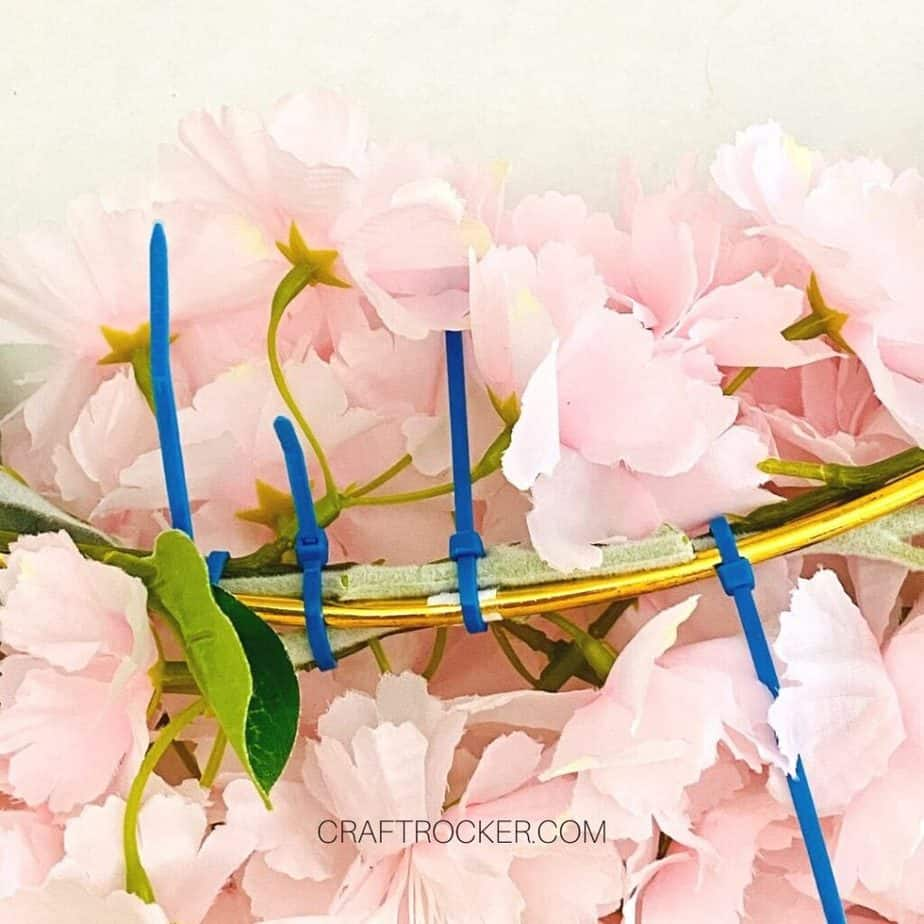 Close Up Zip Ties Holding Flowers and Greenery to Gold Hoop - Craft Rocker