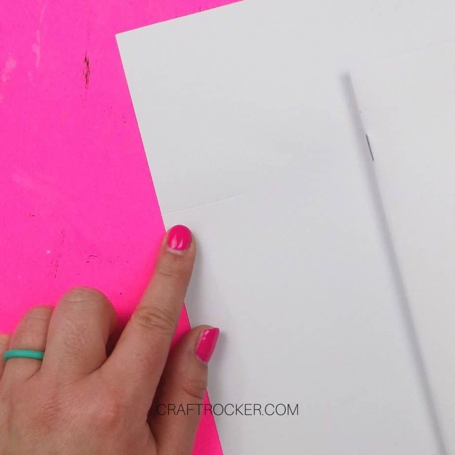 Close Up of Finger Pointing to Indented Line on Paper - Craft Rocker