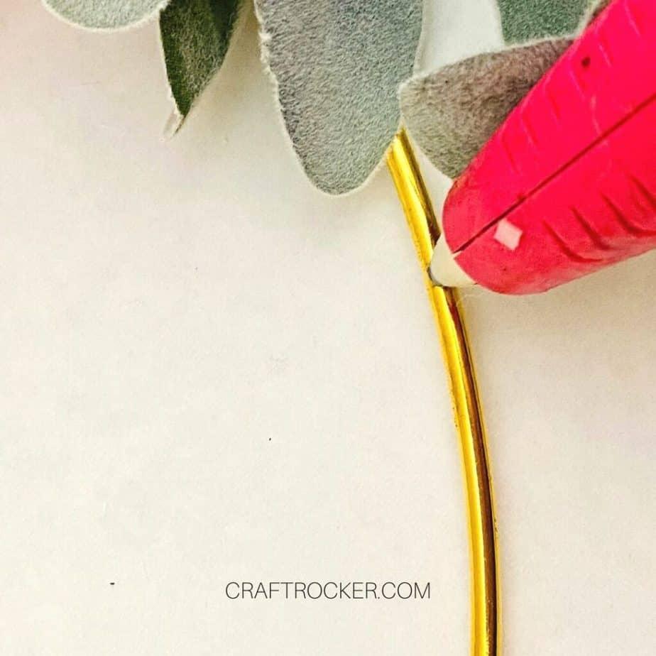 Close Up of Glue Gun Adding Glue to Gold Hoop - Craft Rocker