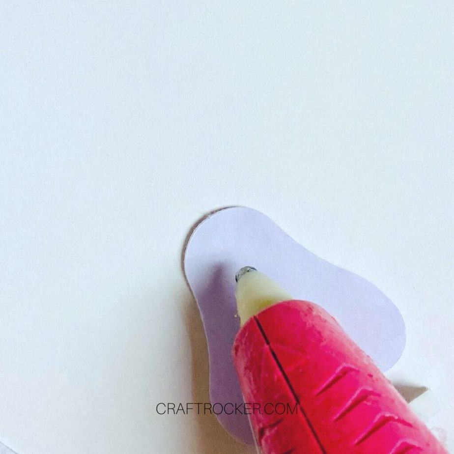 Close Up of Hot Glue Gun Putting Glue on Back of Bunny Foot - Craft Rocker