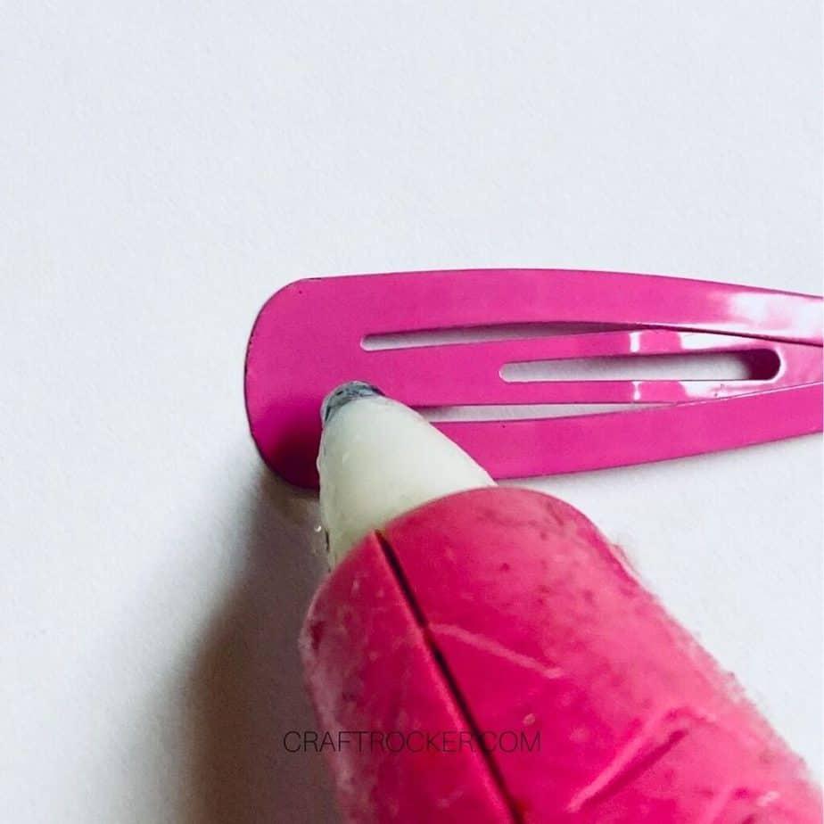 Close Up of Hot Glue Gun Putting Glue on Pink Barrette - Craft Rocker