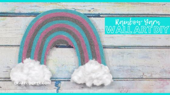 Close Up of Rainbow Art on Wood Background with text overlay - Rainbow Yarn Wall Art DIY - Craft Rocker