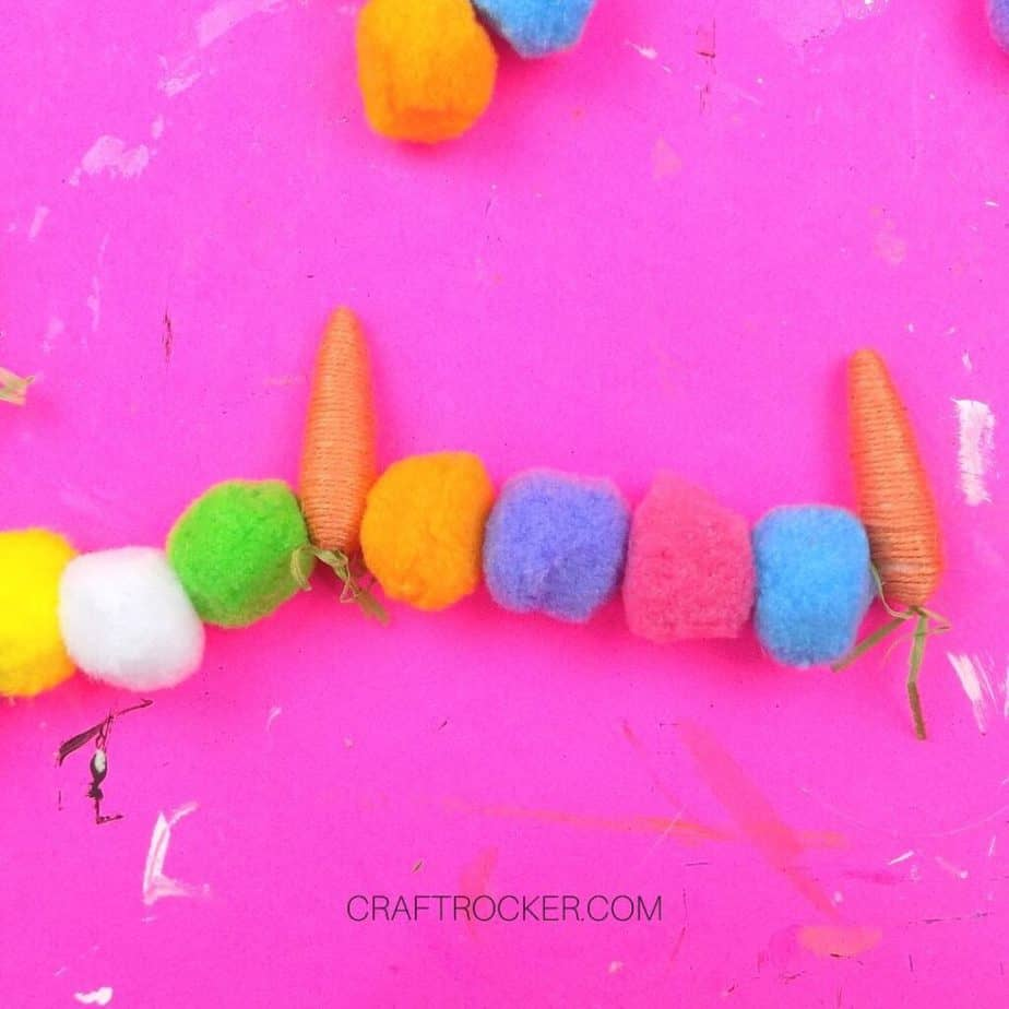 Close Up of Threaded Carrots and Pompoms - Craft Rocker