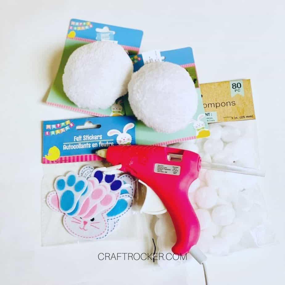 Easter Craft Supplies next to Pompoms and a Glue Gun - Craft Rocker