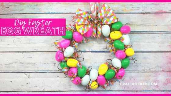 Easter Egg Wreath on Wood Background with text overlay - DIY Easter Egg Wreath - Craft Rocker