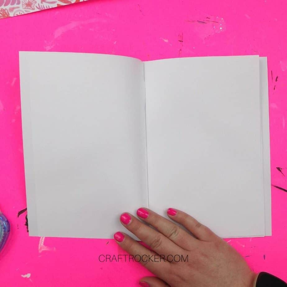 Hand Holding Open Notebook with Cover Glued to It - Craft Rocker