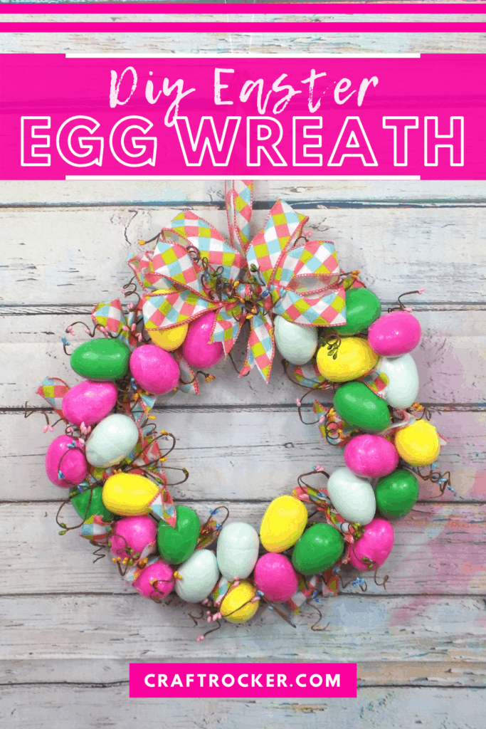 Hanging Easter Egg Wreath on Wood Background with text overlay - DIY Easter Egg Wreath - Craft Rocker