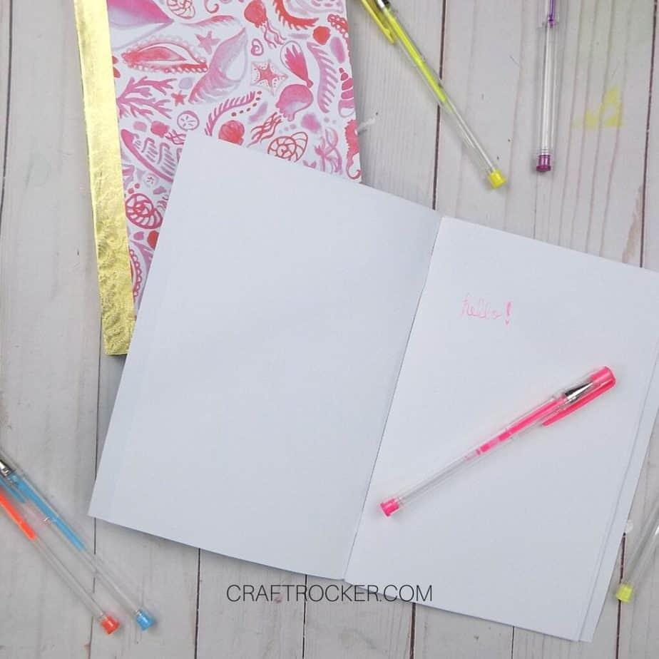 Open Notebook with Writing next to Gel Pens - Craft Rocker