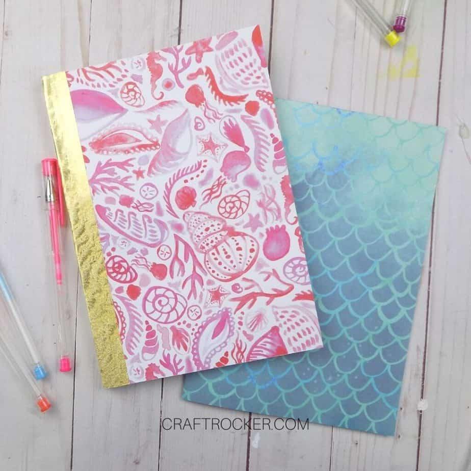 Pink Seashell Notebook on top of Mermaid Notebook next to Gel Pens - Craft Rocker