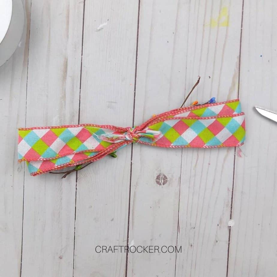 Small Length of Ribbon Tied Around Wrapped Ribbon and Floral Sprays - Craft Rocker
