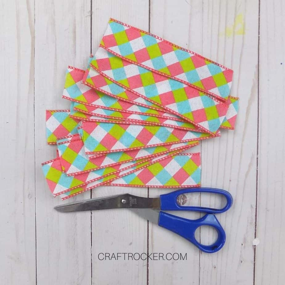 Strips of Diamond Ribbon next to Scissors - Craft Rocker