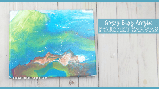 Close Up of Blue Fluid Art Canvas on Wood Background with text overlay - Crazy Easy Acrylic Pour Art Canvas - Craft Rocker