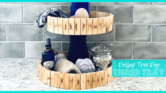 Close Up of Tiered Tray with Toiletries Inside with text overlay - Dollar Tree DIY Tiered Tray - Craft Rocker