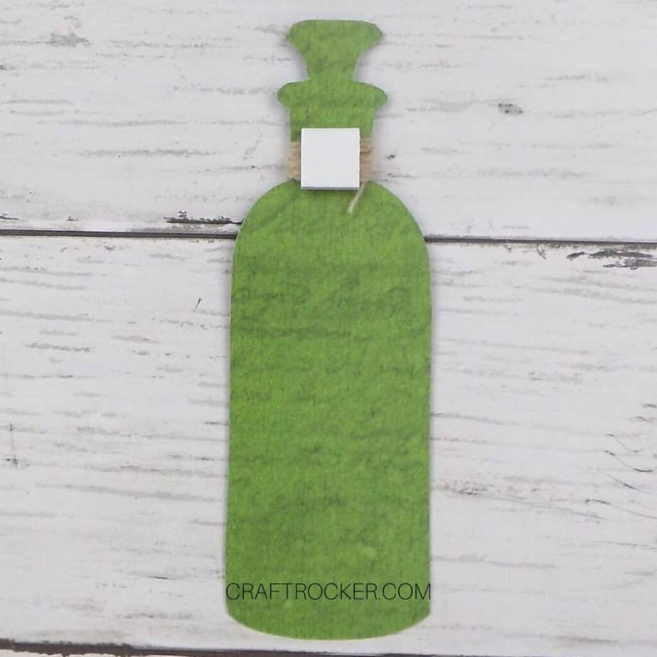 Adhesive Foam Square Attached to Twine on Back of Poison Bottle Embellishment - Craft Rocker