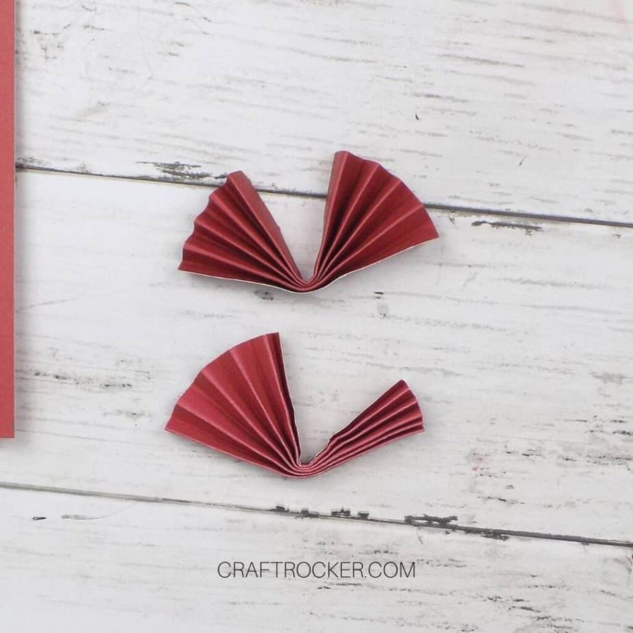 Close Up of 2 Accordion Folded Pieces of Red Paper - Craft Rocker