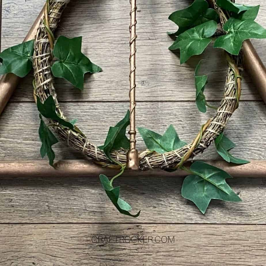 Close Up of Bottom Copper Harry Potter Wreath on Wood Background - Craft Rocker