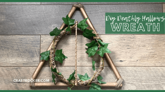 Close Up of Copper Harry Potter Wreath on Wood Background with text overlay - DIY Deathly Hallows Wreath - Craft Rocker
