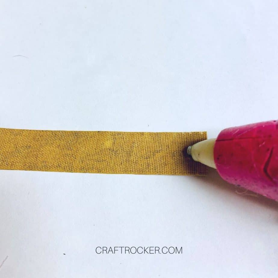 Close Up of Glue Gun Putting Hot Glue on Back of Cork Ribbon - Craft Rocker