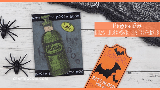Close Up of Handmade Poison Card next to Spiders and Netting with text overlay - Poison DIY Halloween Card - Craft Rocker