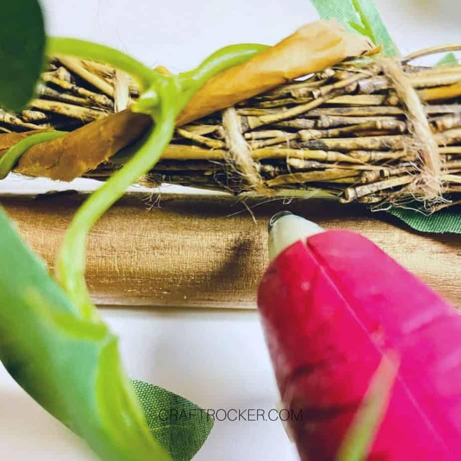 Close Up of Hot Glue Gun Adding Glue to Vine Wrapped Wreath - Craft Rocker