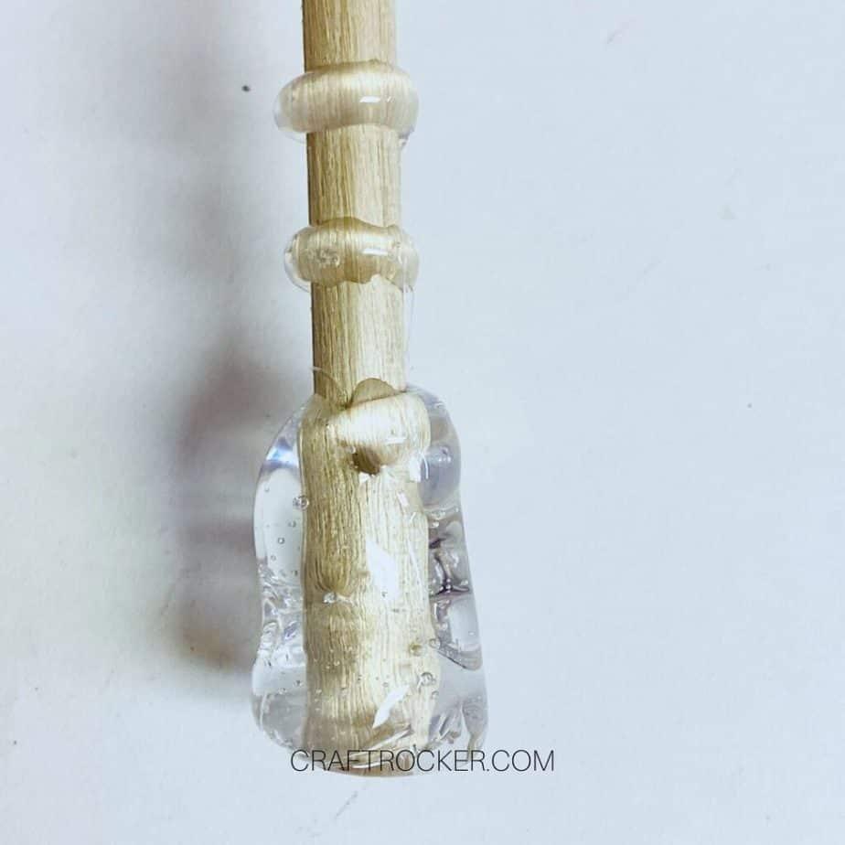 Close Up of Hot Glue on Bottom of Dowel Rod - Craft Rocker