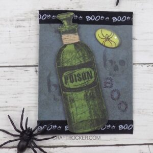 Close Up of Poison Bottle Card next to Spiders - Craft Rocker