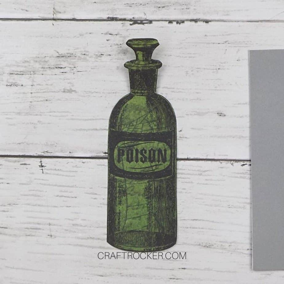 Close Up of Poison Bottle Cut Out of Paper - Craft Rocker