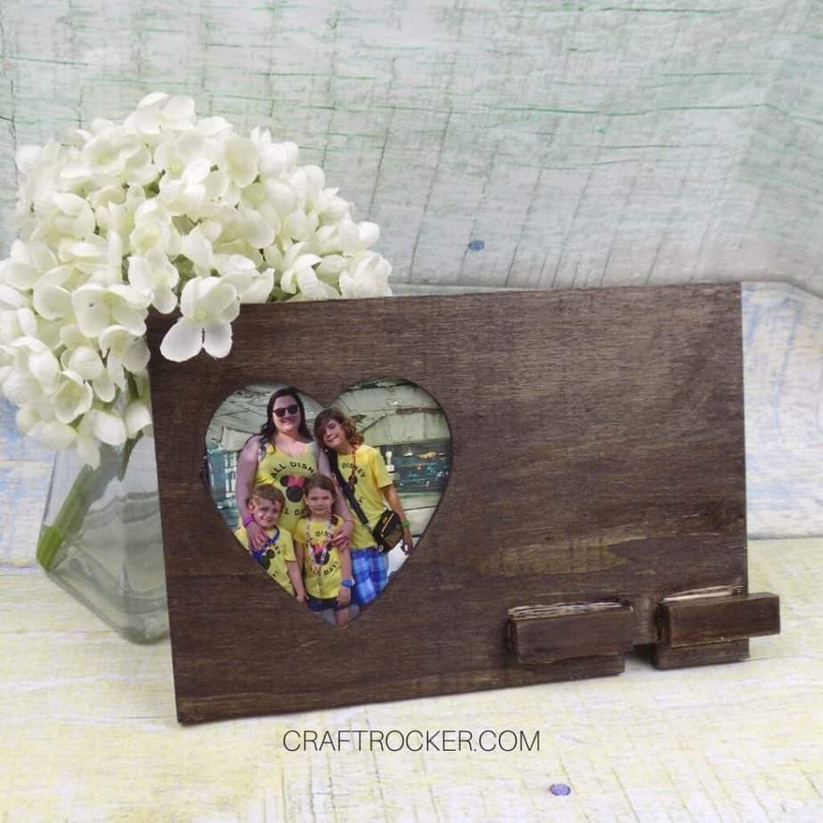 Flower Arrangement next to Wood Phone Holder - Craft Rocker
