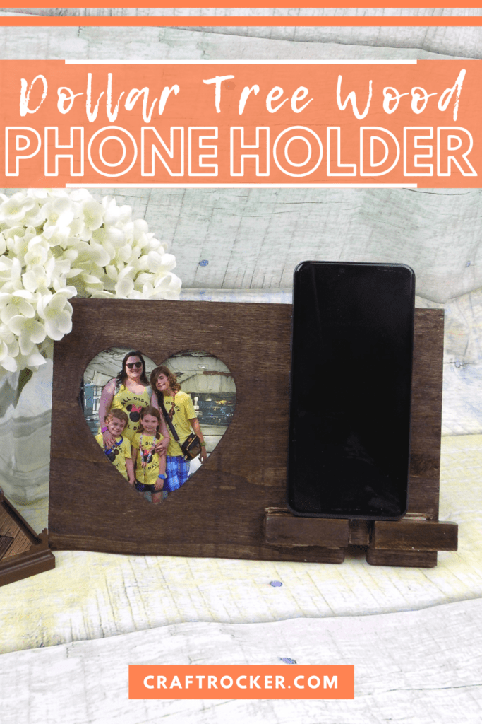 Heart Frame Phone Holder next to Flowers with text overlay - Dollar Tree Wood Phone Holder - Craft Rocker