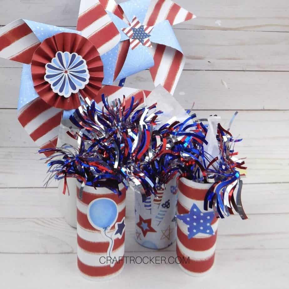 Paper Firecracker Party Favors and Paper Pinwheels on Wood Background - Craft Rocker